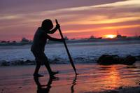Boy playing at sunset in San Juan del Sur, Nica