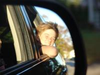 SMILING IN THE SIDE-MIRROR