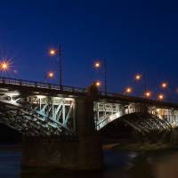 Night bridge in Warsaw, long exposition Art Prints & Posters by Lukasz Mlodzinski