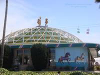 Carousel House with sky ride in background