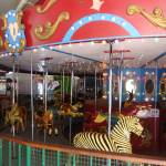 """Carousel @ Ventura Village Carousel- Ventura Villa"" by laughingclaw"