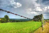hdr storm behind barbwire signed
