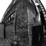 """Brick Building Fish Eye view"" by photoworld78"