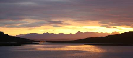sunrise over  scottish mainlland from skye