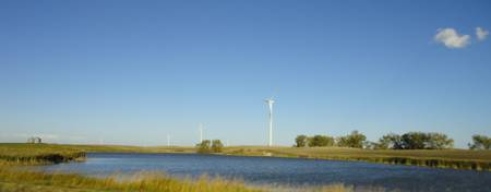 WindTurbine on the Prairie by water