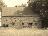 Stone barn in sepia