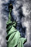 Statue of Liberty against turbulent skies Poster