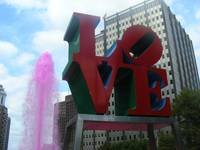 love statue with pink fountain
