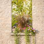 """Rustic Stone Window with Flower Box"" by mackflix"