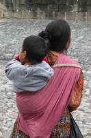 woman with baby on back antigua guatemala