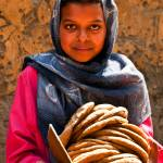 """Egyptian girl with pita, Luxor"" by ileneperlman"