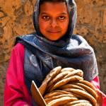 """Egyptian girl with pita, Luxor"" by ileneperlman"
