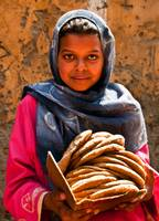 Egyptian girl with pita, Luxor