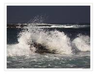 Surf breaking on rocks at Sennen Cove Cornwall