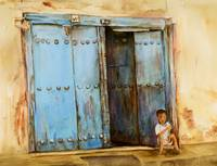Child sitting in Zanzibar Doorway