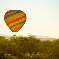 """Hot Air Balloon in the Beautiful Lush Arizona Dese"" by lightningman"
