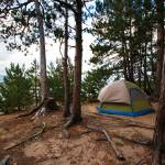 """Tent Camping Campsite in the Woods Off the Beach"" by mackflix"