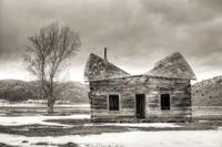 Old log cabin in the snow