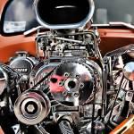 """Blown - Superchared Engine in Orange Street Rod"" by pi"