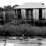 """House on the Water, Benin"" by cybergypsie"