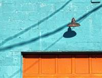 Orange garage door blue wall