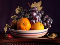 Fruit bowl with grapes and oranges