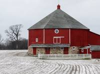 Red round barn and snow