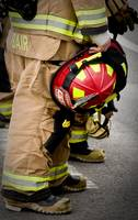 Firefighter and helmet