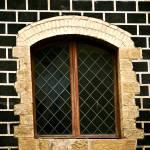 """Black Bricked Window"" by raetucker"