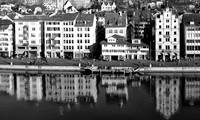 Old city reflecting on the river Limmat