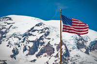 American Flag Waves in Front of Mt. Rainier