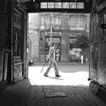 """street shot of a man walking"" by katta"