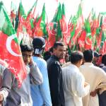 """PTI Supporter outside Rally in Karachi, Pakistan"" by GrayScale"