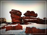 Red rocks on snow