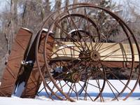 Old wheels in a winter landscape