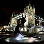 """Girl and Dolphin Statue and Tower bridge"" by DavidHornchurch"