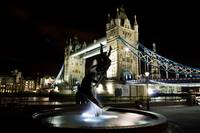 Girl and Dolphin Statue and Tower bridge