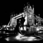"""Girl And Dolphin Statue near Tower Bridge London"" by DavidHornchurch"