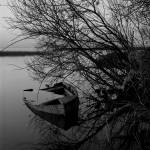 """Abandoned rowboat"" by RickAcadie"