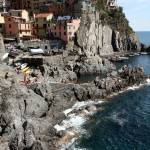"""Rock Beach at Manarola"" by DonnaCorless"