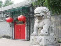 Chinese lion and red gate