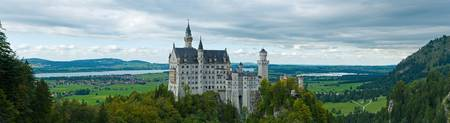 Castle Neuschwanstein with surrounding landscape