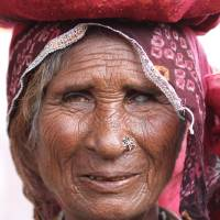 Old woman in Pushkar Art Prints & Posters by Mark Seath