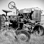 """Time and Metal: Tractor in a Field"" by PaulHuchton"