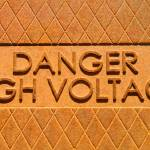 """Danger High Voltage Manhole Cover Sign"" by ultimateplaces"