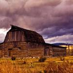 """Stormy Sunset over Moulton Barn"" by BrianKerls"