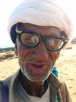 Old Snake Charmer on Beach