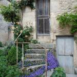"""Medieval Staircase with Flowers"" by marilyndunlap"