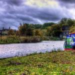 """Narrowboat on River"" by InspiraImage"