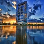 """Anadarko Tower reflected in Lake Robbins"" by JoelOlives"